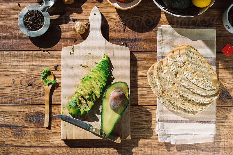 Avocado and Bread on the Table by Mosuno for Stocksy United