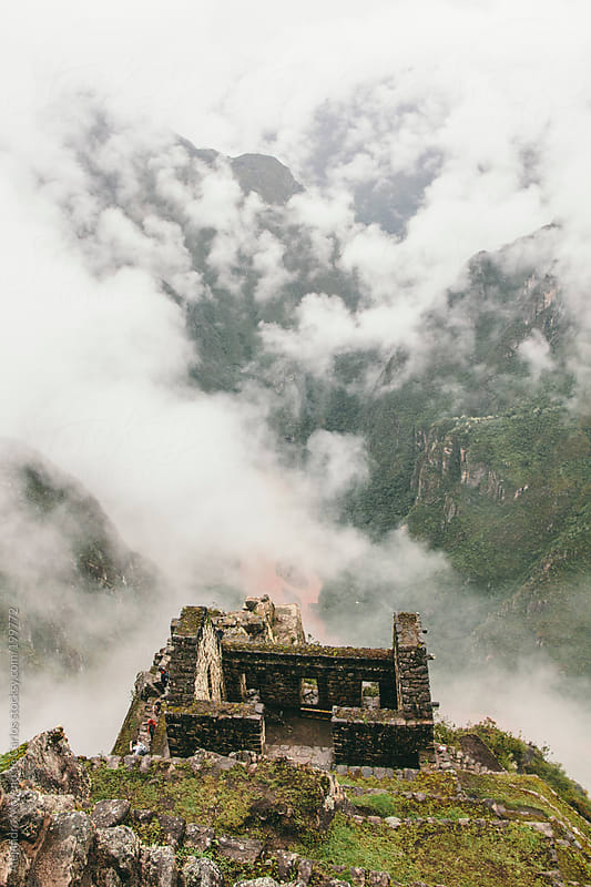 Machu Picchu Inca ancient ruins and clouds on the valley by Alejandro Moreno de Carlos for Stocksy United