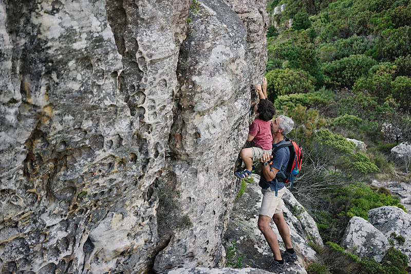 Father and Son Rock Climbing by Bruce Meissner for Stocksy United