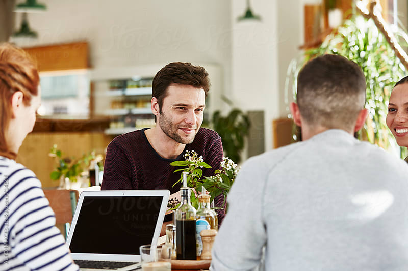 Business People In Discussion At Restaurant Table by ALTO IMAGES for Stocksy United