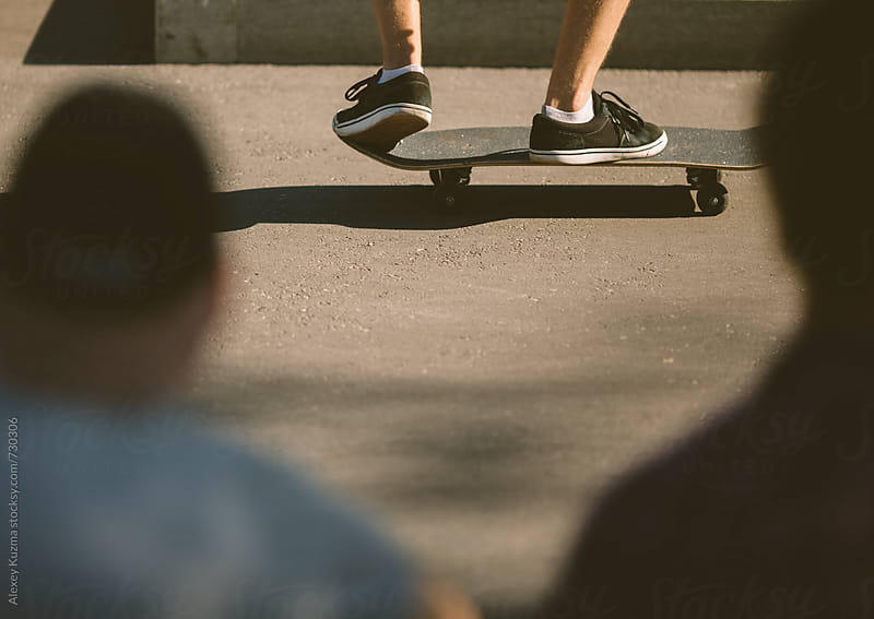 Sneakers Shoes on a Skateboard by Alexey Kuzma for Stocksy United