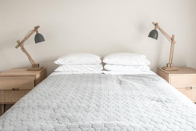 modern minimalist bedroom by Gillian Vann for Stocksy United