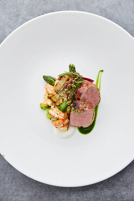 Gourmet food dish on plate by Trinette Reed for Stocksy United