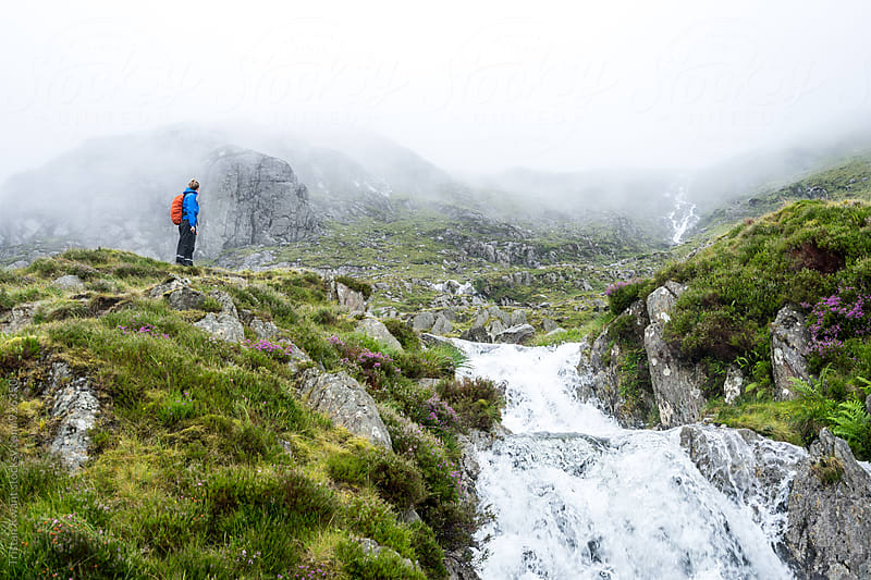 Female hiker in rugged mountains. by Tristan Kwant for Stocksy United