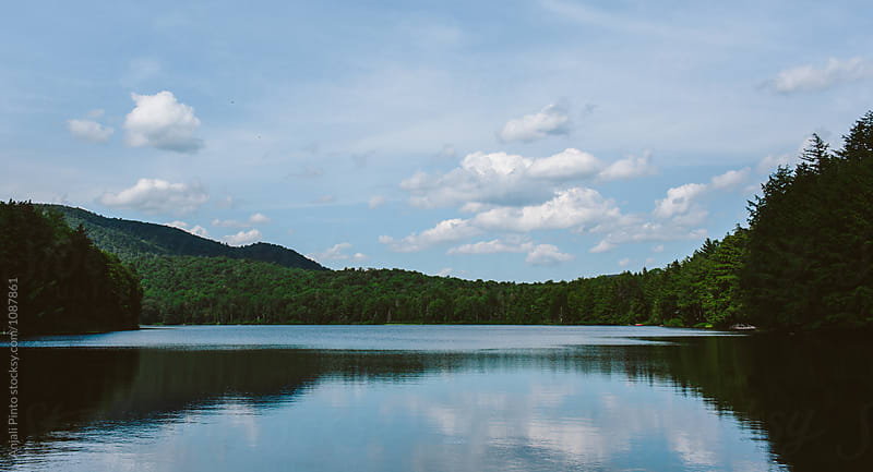 Clouds Reflected on a Private Lake by Anjali Pinto for Stocksy United