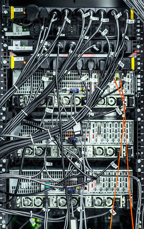 Complex array of wires at back of server cabinet by MaaHoo Studio for Stocksy United