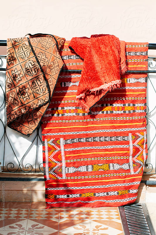 Handmade Moroccan rugs drying in the sun. by Darren Muir for Stocksy United