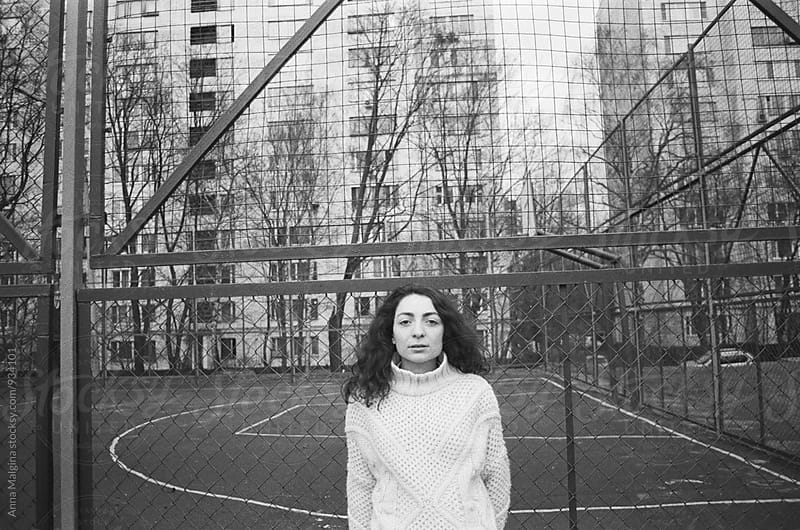 A black and white portrait of a young beautiful woman on playground by Anna Malgina for Stocksy United