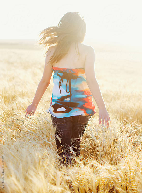 Running in the wheat by Tana Teel for Stocksy United