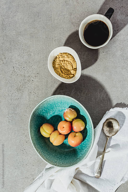 Apricots, pollen and coffee by Tatjana Zlatkovic for Stocksy United