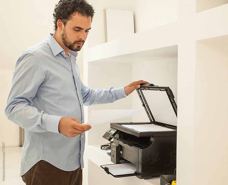 Man Using Printer in the Office by Mosuno for Stocksy United