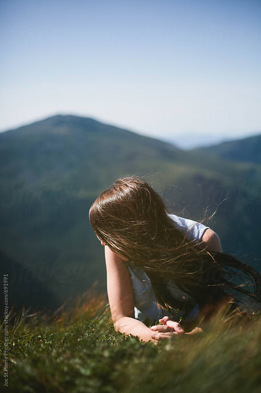 Young woman on top of mountain  by Joe St.Pierre Photography for Stocksy United