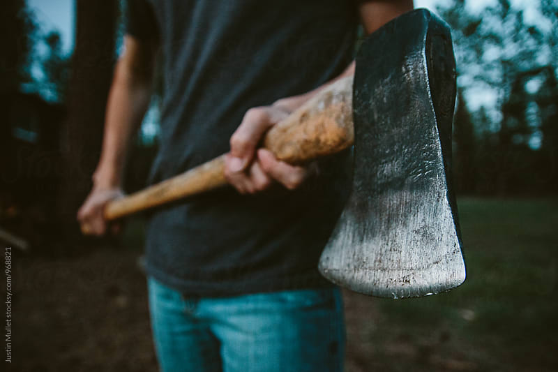 Holding an ax by Justin Mullet for Stocksy United