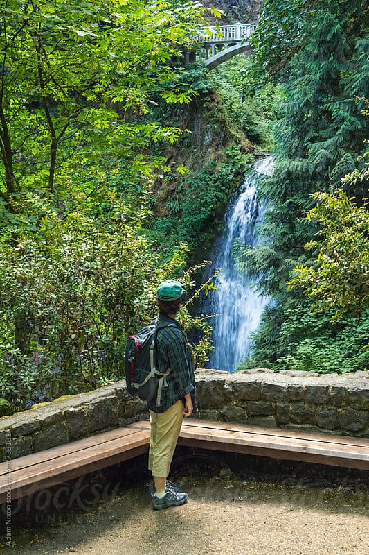 A female hiker looking at Multnomah Falls, Columbia River Gorge, Oregon by Adam Nixon for Stocksy United