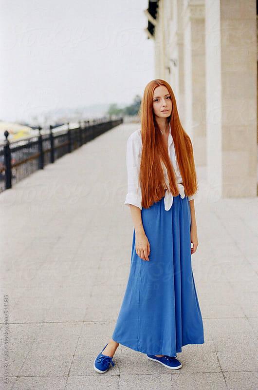 Beautiful woman with long ginger hair looking at camera by Lyuba Burakova for Stocksy United