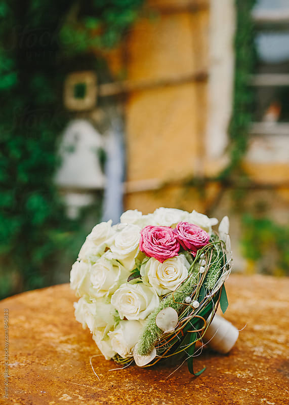 Delicate bridal bouquet of fresh roses by Amir Kaljikovic for Stocksy United
