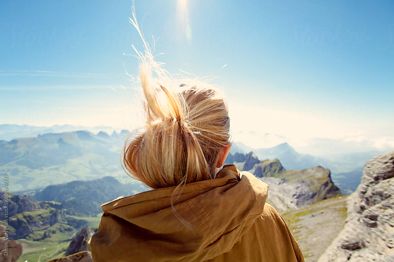 Happy woman on top of a mountains looking out at the view. by Denni Van Huis for Stocksy United