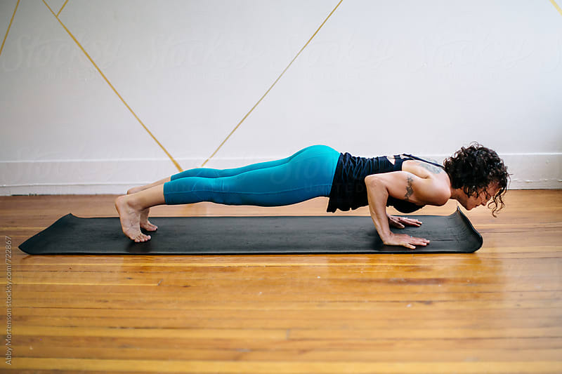 Woman in low Plank Position by Abby Mortenson for Stocksy United
