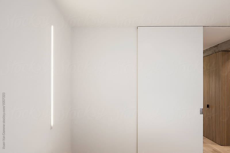 tube lamp and sliding door by Koen Van Damme for Stocksy United