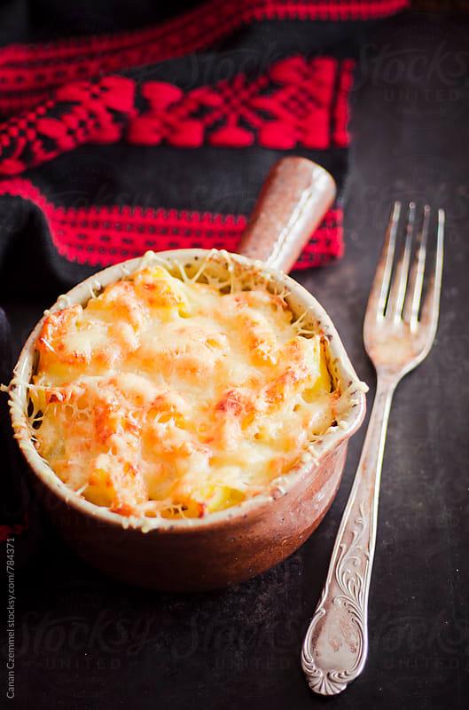 pasta-potato-gratin by Canan Czemmel for Stocksy United