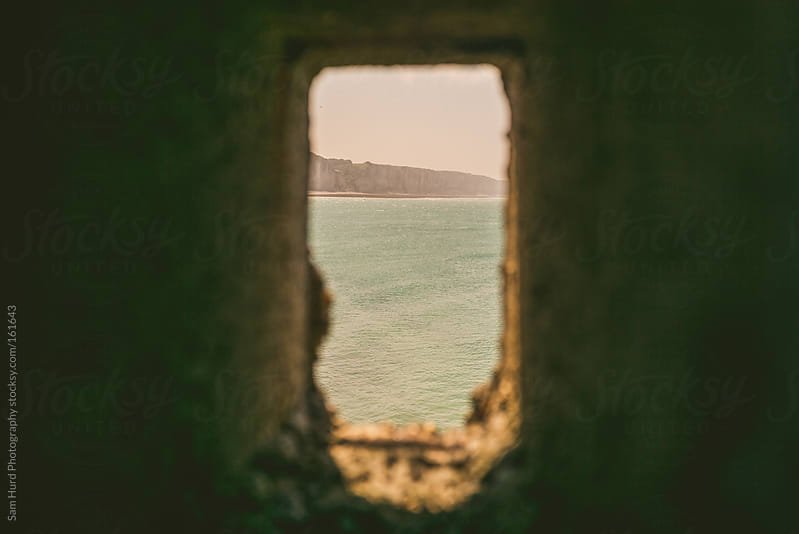 beach through a window by Sam Hurd Photography for Stocksy United