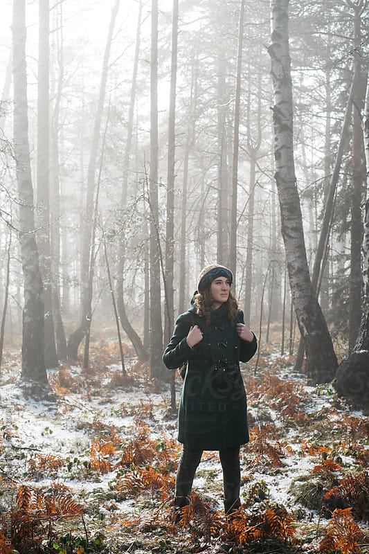 Young woman hiking in the woods by Brkati Krokodil for Stocksy United
