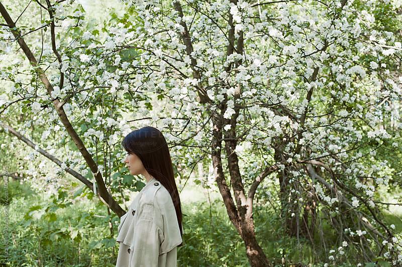 Woman at cherry blossom  by Lyuba Burakova for Stocksy United