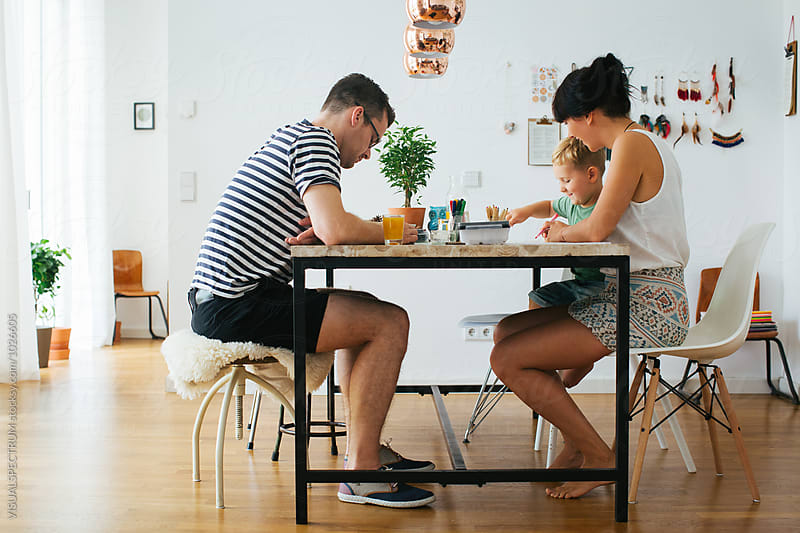 Family at Home - Young Parents Painting With Small Blond Boy in Bright Stylish Living Room by Julien L. Balmer for Stocksy United