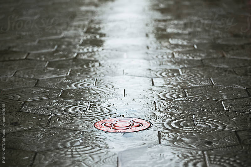 Modernist route on Barcelona streets. Tiles of street on rainy day.  by BONNINSTUDIO for Stocksy United