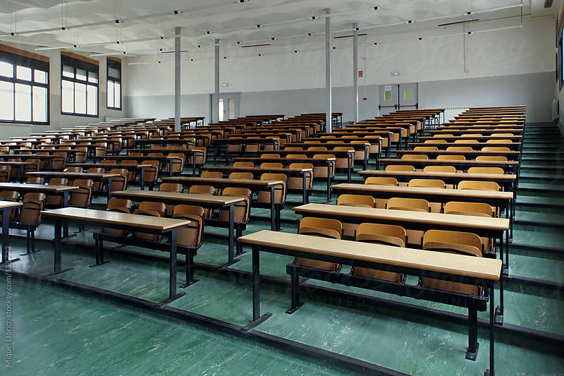 Empty auditorium of an old school with a green floor by Miquel Llonch for Stocksy United
