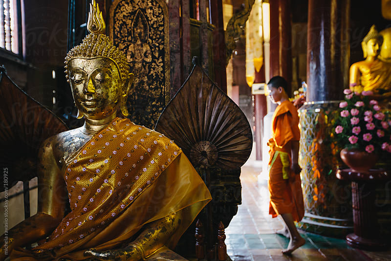 Young monk in a Buddhist temple by michela ravasio for Stocksy United