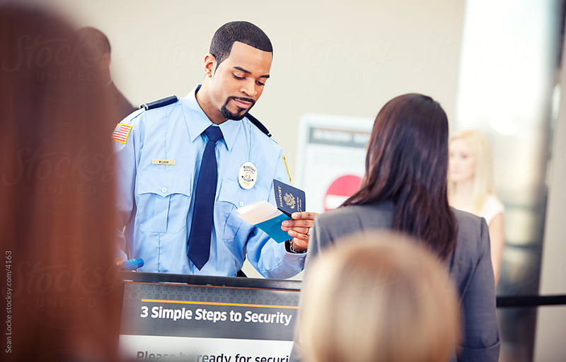 Airport: Airline Security Guard Checks Passport by Sean Locke for Stocksy United