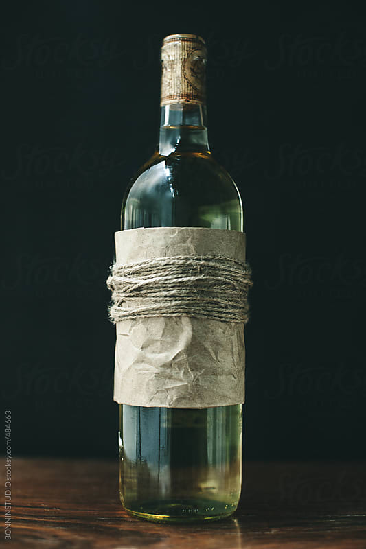 White wine bottle gift on a black background. by BONNINSTUDIO for Stocksy United