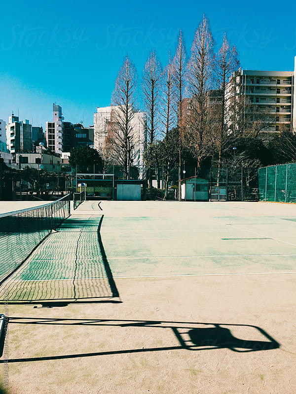 Empty Tennis Court on Sunny Day by Julien L. Balmer for Stocksy United