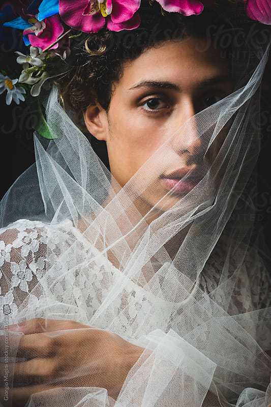 Feminine Boy with Veil and Flowers Crown, Studio Shot by Giorgio Magini for Stocksy United