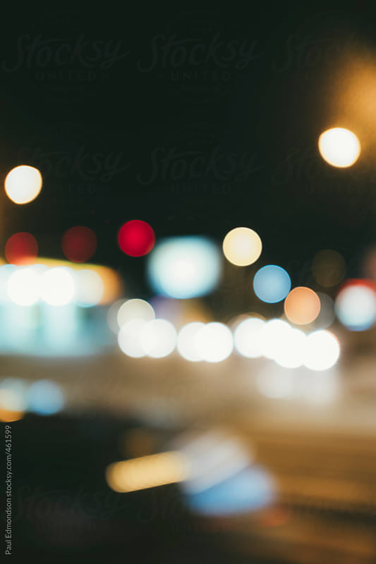 Abstract of car and street lights at night, blurred focus by Paul Edmondson for Stocksy United