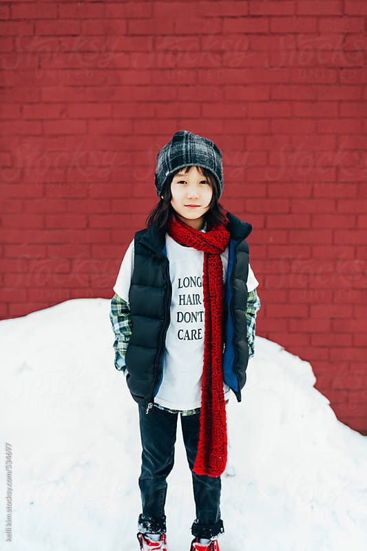 Young mixed race boy in snow by kelli kim for Stocksy United