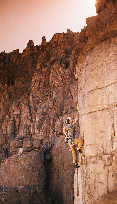 Man rock climbing by Micky Wiswedel for Stocksy United