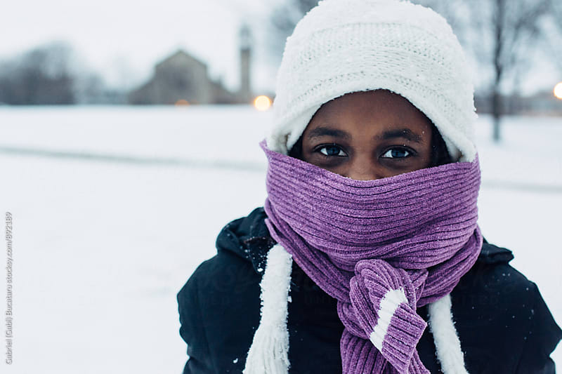 Bundled up black girl with purple scarf in the snow by Gabriel (Gabi) Bucataru for Stocksy United