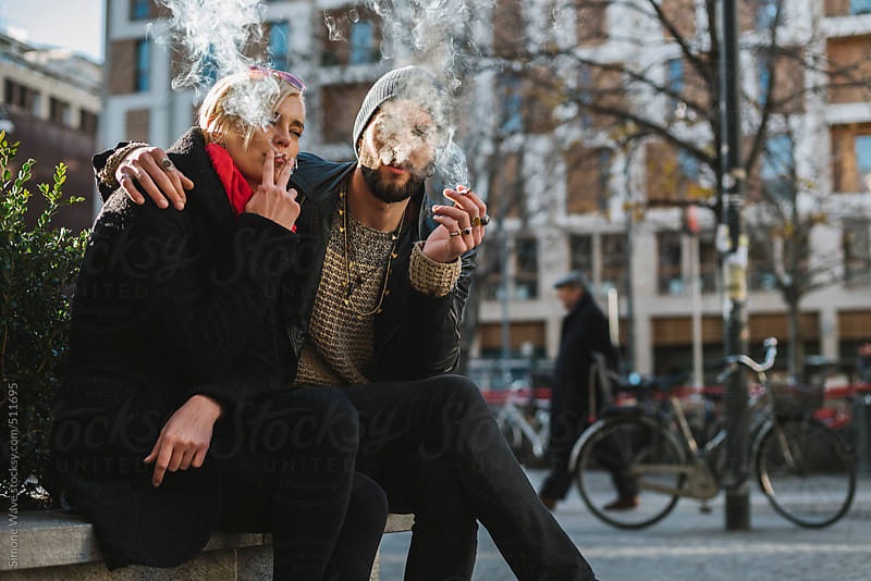 Young people smoking cigarette in the city by GIC for Stocksy United