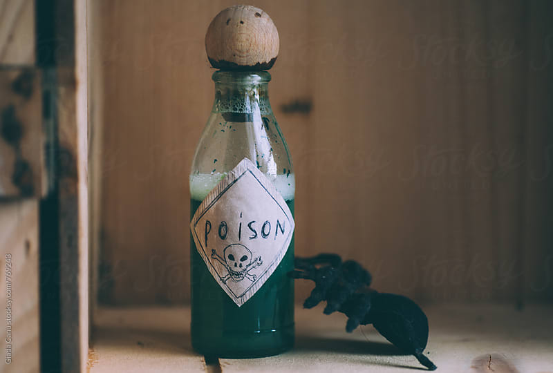 A bottle full of poison by Giada Canu for Stocksy United