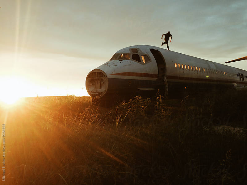 Abandoned Plane at Sunrise by Michael Tucker for Stocksy United