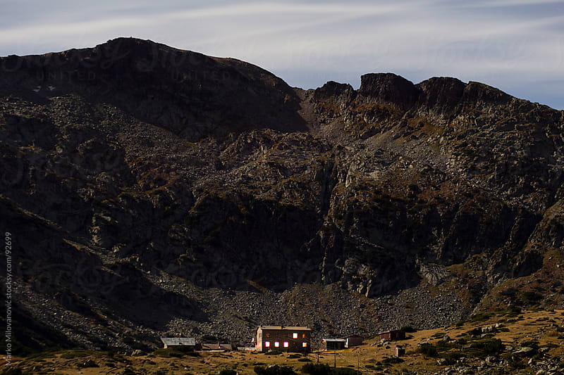 House in the mountain, night time by Marko Milovanović for Stocksy United