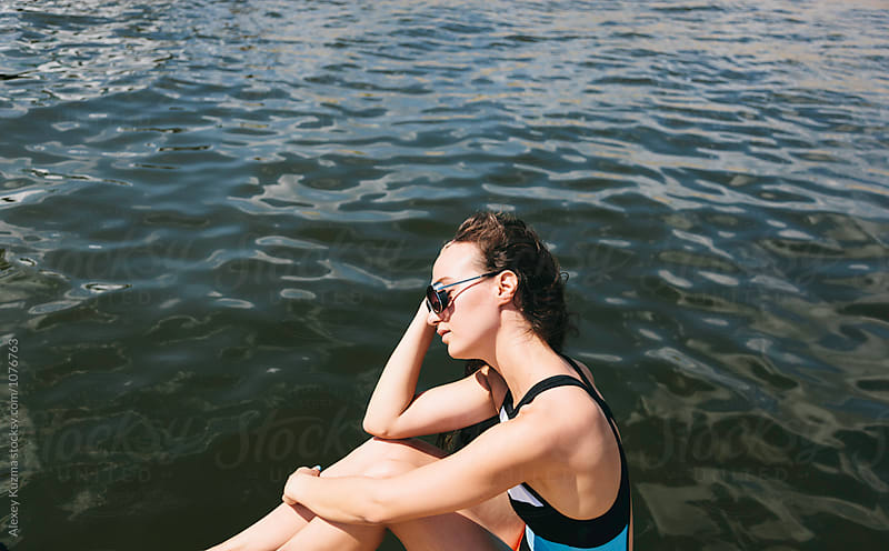 young woman relax near the water by Alexey Kuzma for Stocksy United