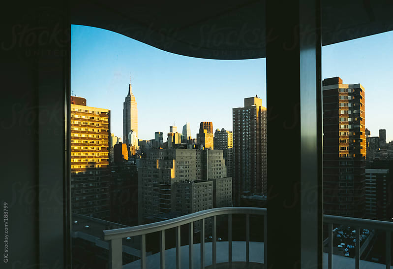 New York skyline with Empire from a house window by GIC for Stocksy United
