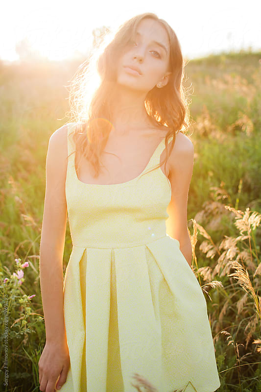 Sunset portrait of a young woman by Sergey Filimonov for Stocksy United