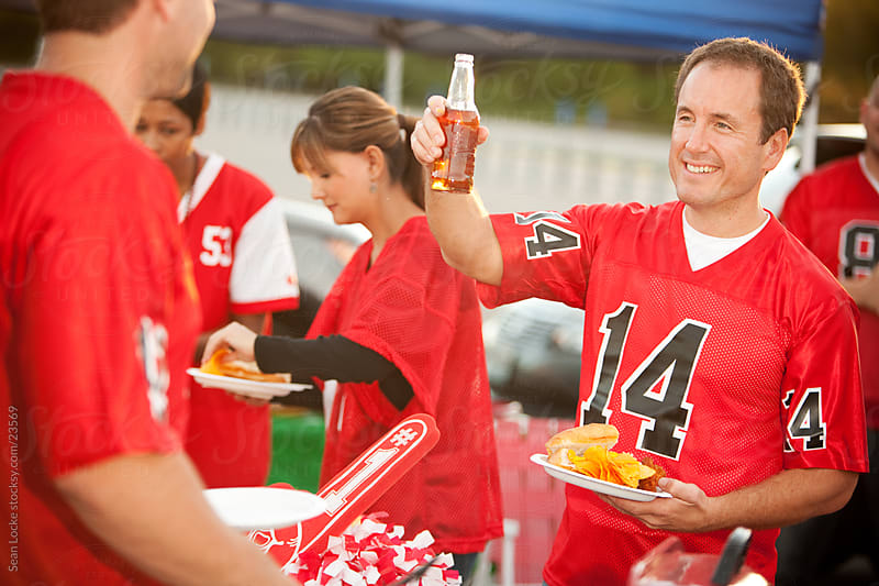 Tailgating: Guy Toasts His Favorite Team by Sean Locke for Stocksy United