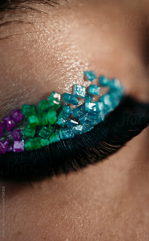 Closeup of eyelashes and colorful eyeshadow by Beatrix Boros for Stocksy United