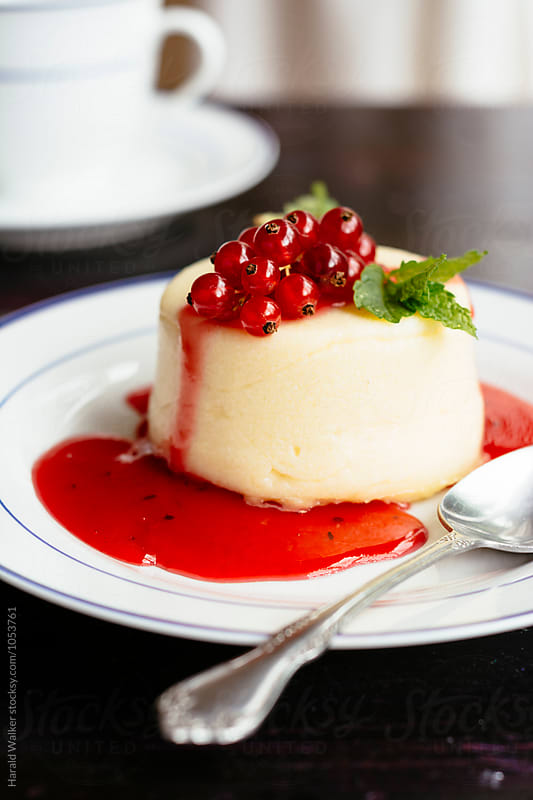 Semolina Pudding with Red Currant Sauce by Harald Walker for Stocksy United