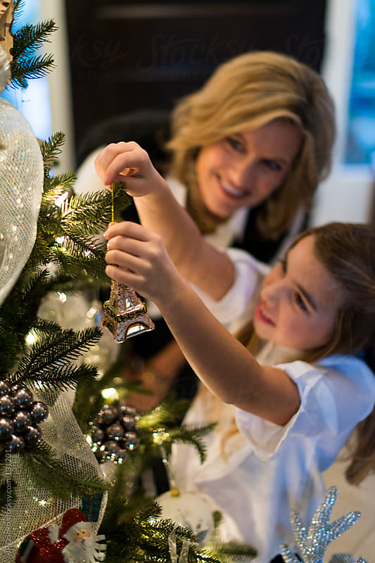 Mother and Little Girl Decorating Christmas Tree for Christmas by JP Danko for Stocksy United